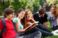 Young college students relaxing outdoors